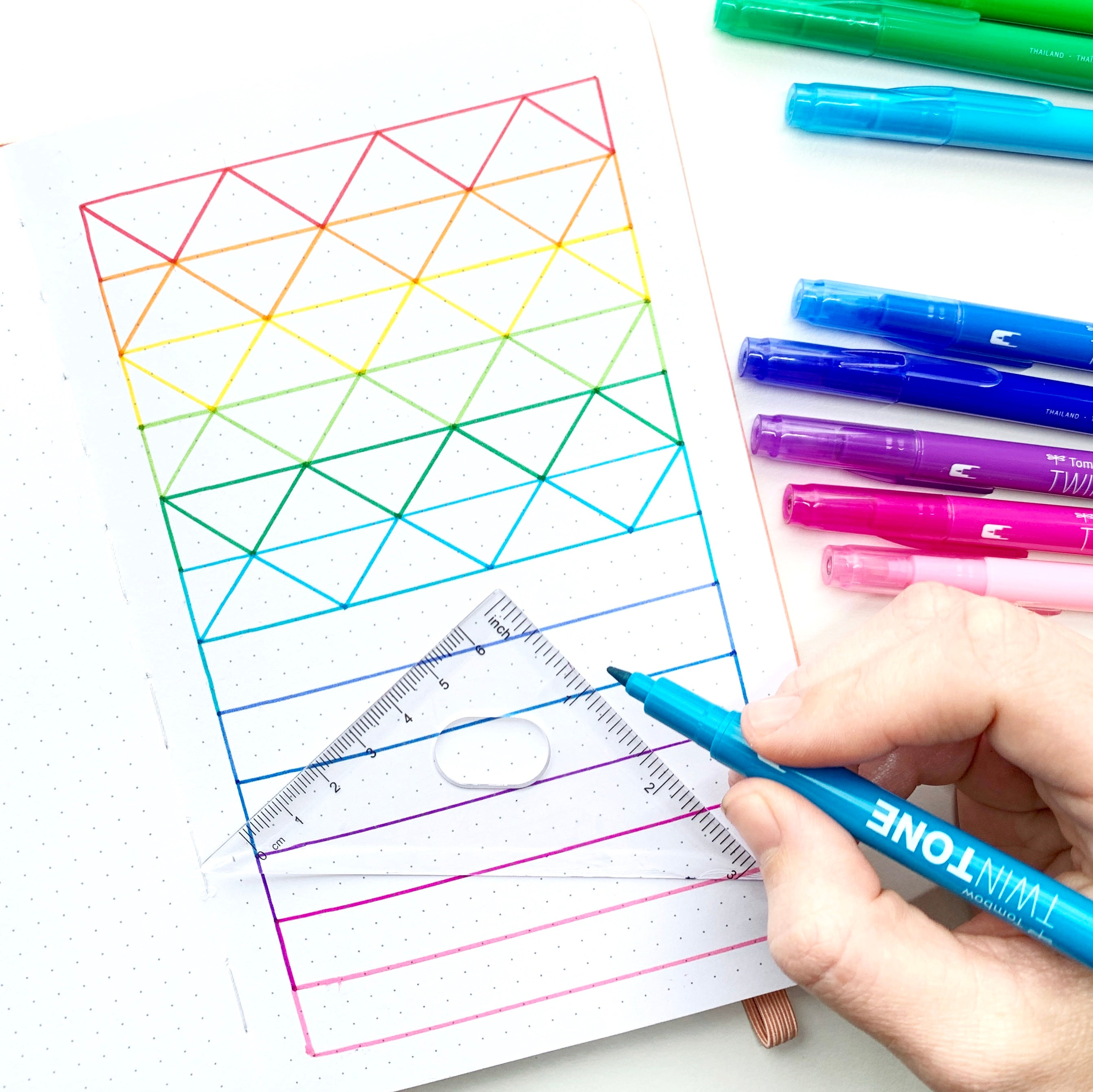 Learn how to create a rainbow pattern in your dot grid notebook with Adrienne from @studio80design