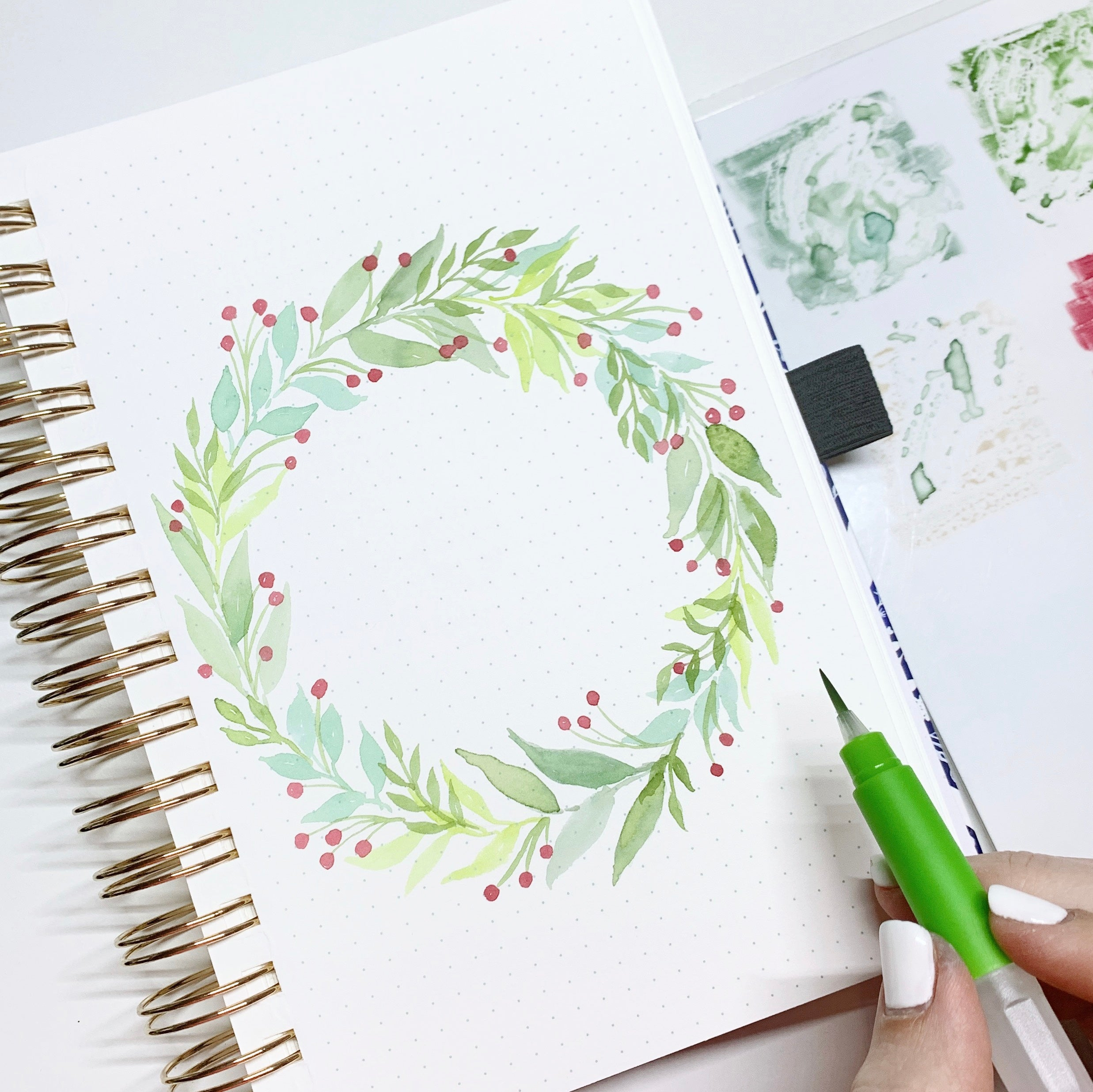 Learn how to create a holiday watercolor wreath with Adrienne from @studio80design!