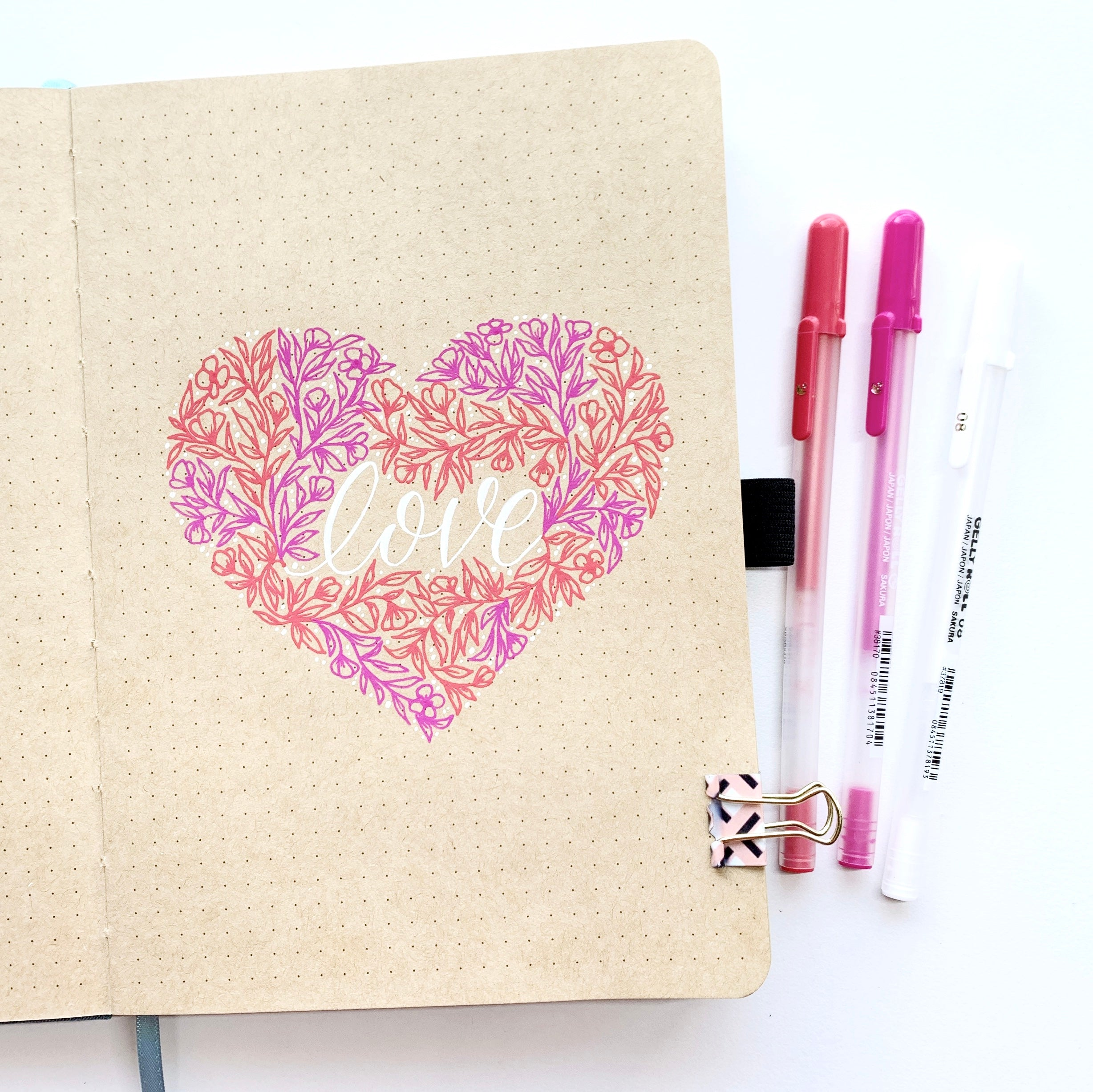 Learn how to create a floral heart illustration in the NEW Kraft Paper Dot Grid Notebook with Adrienne from @studio80design!