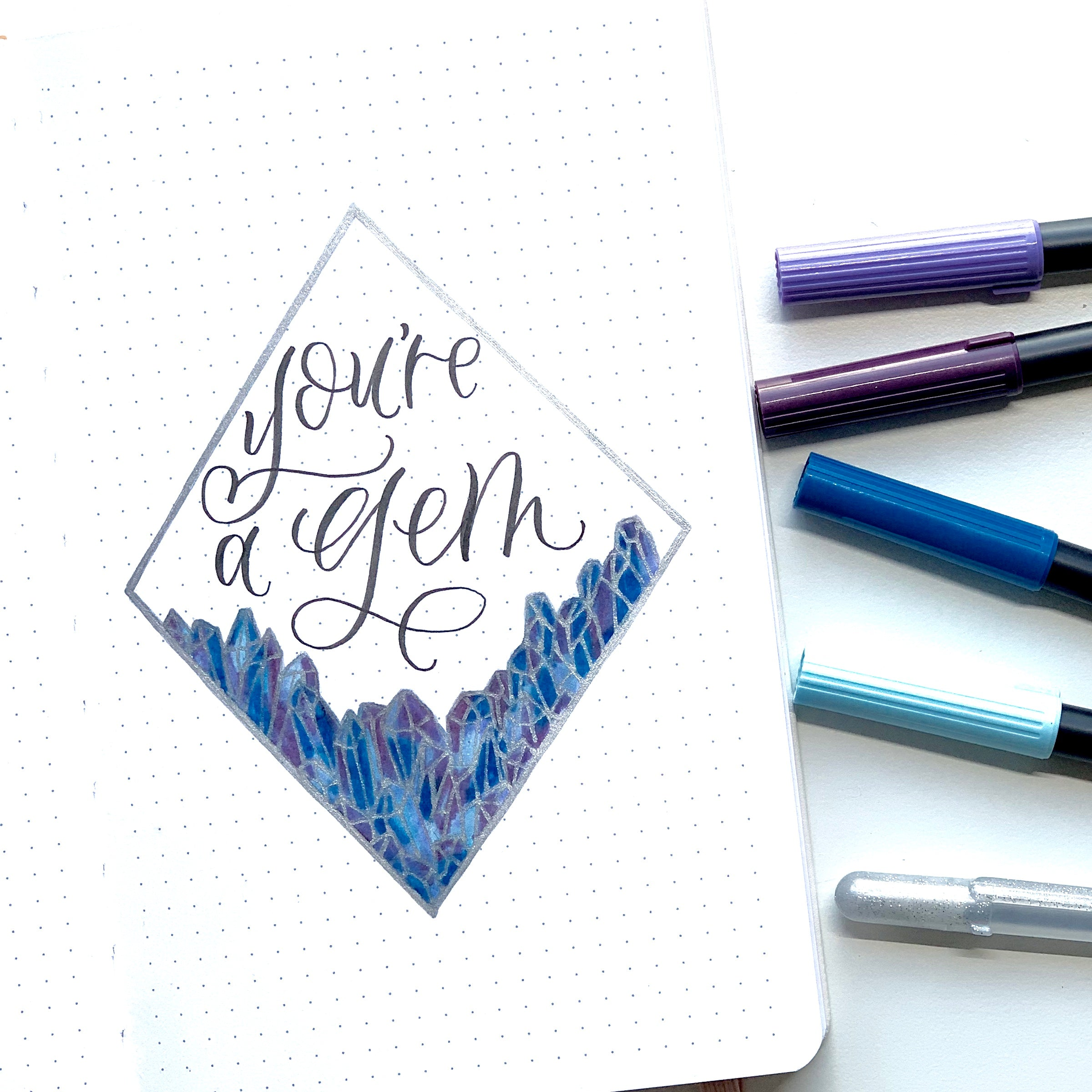 Learn how to create a crystal border in your bullet journal with Adrienne from @studio80design!