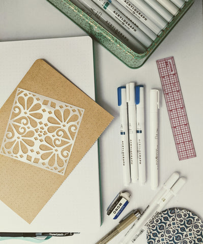 pens, notebook, and stencils supplies