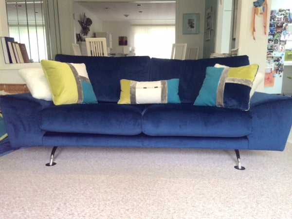 After Blue Sofa with Decorative Pillows