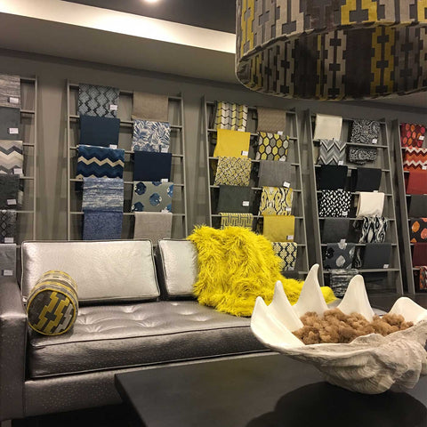 Top Fabric Showroom with Faux Fur Blanket and Upholstery Fabric Yardage