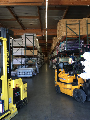 State of the Art Warehouse with Long Tall Isles and Forklifts