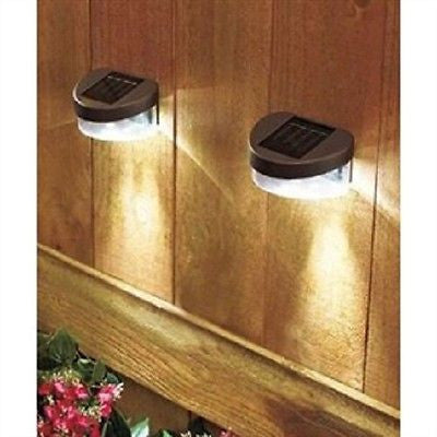 Set of 2 Solar Fence Lights with LED lights and Ni Cd battery - YourGardenStop