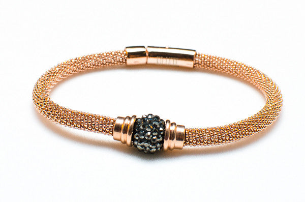 Carried Away gold bracelet with black pave center stone