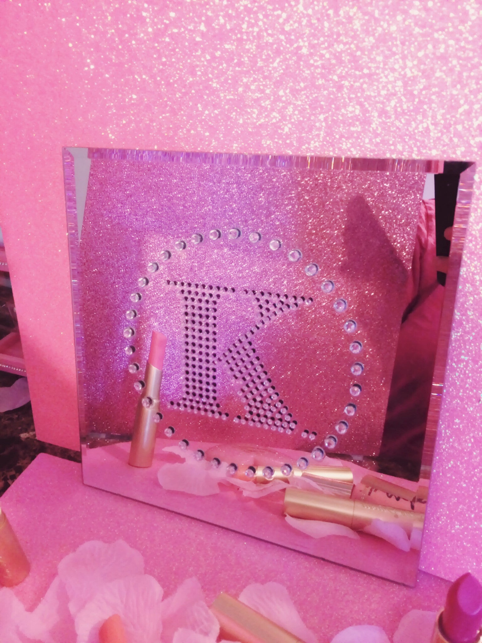 Letter K with rhinestones on a decor mirror