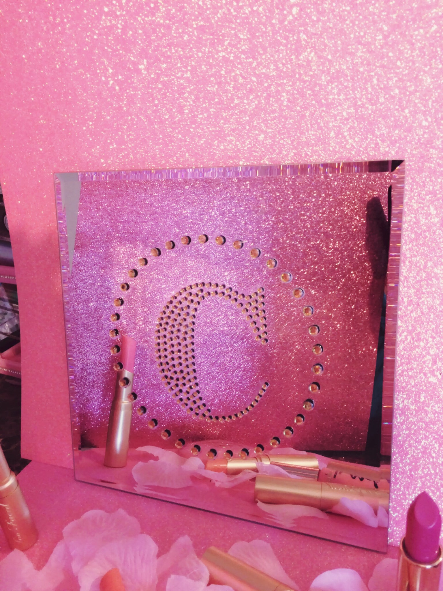 Letter C with rhinestones on a decor mirror