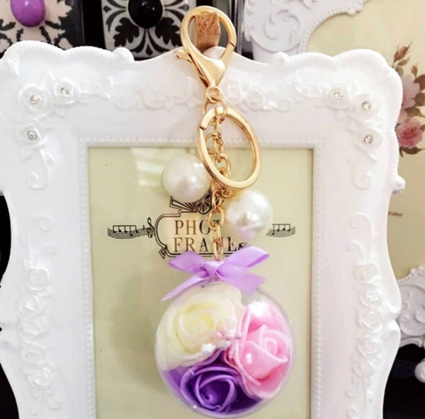 Roses in a clear ball bag charm keychain