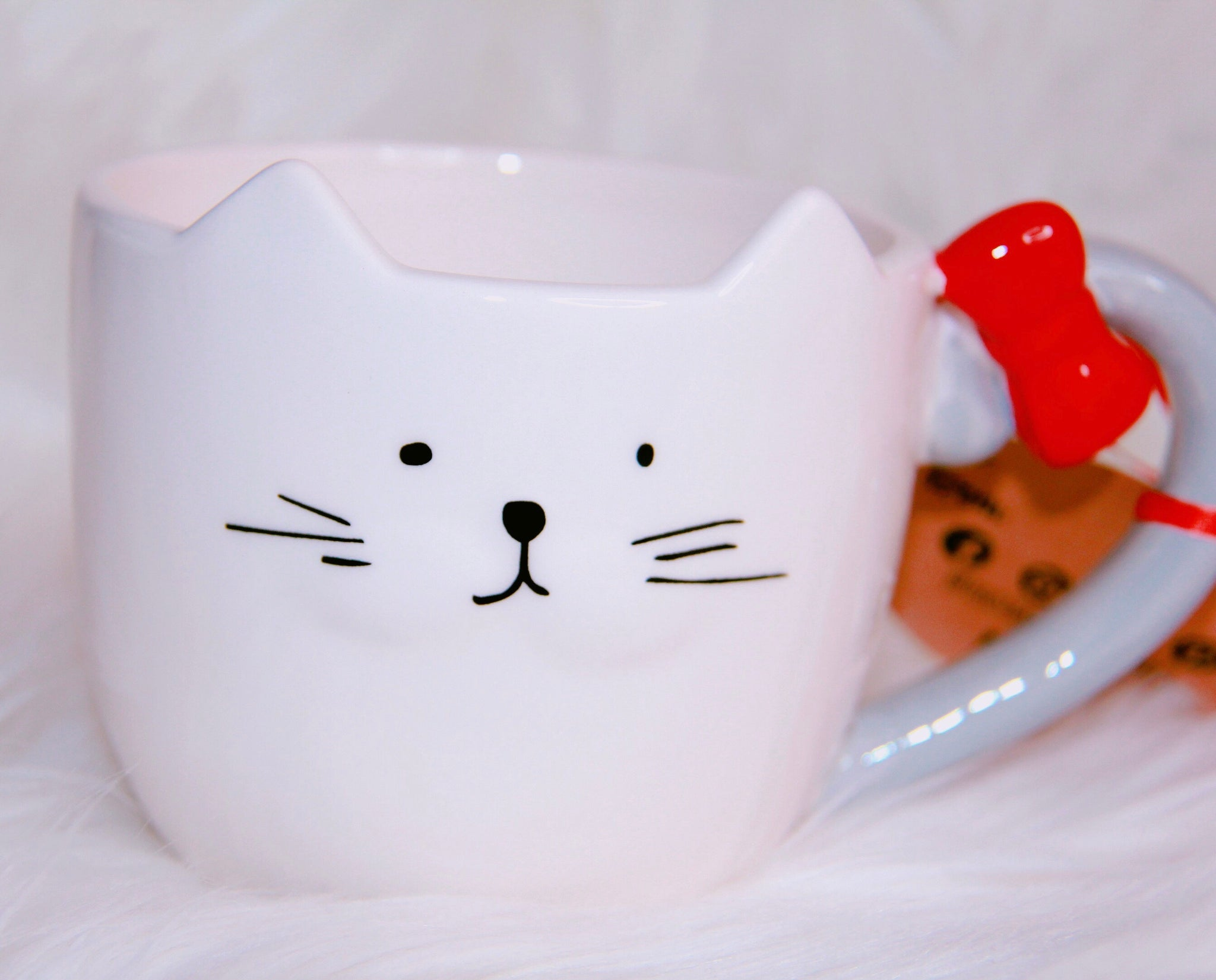 Cat with a red bow mug