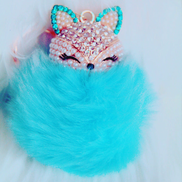 Light blue foxy pom pom bag charm