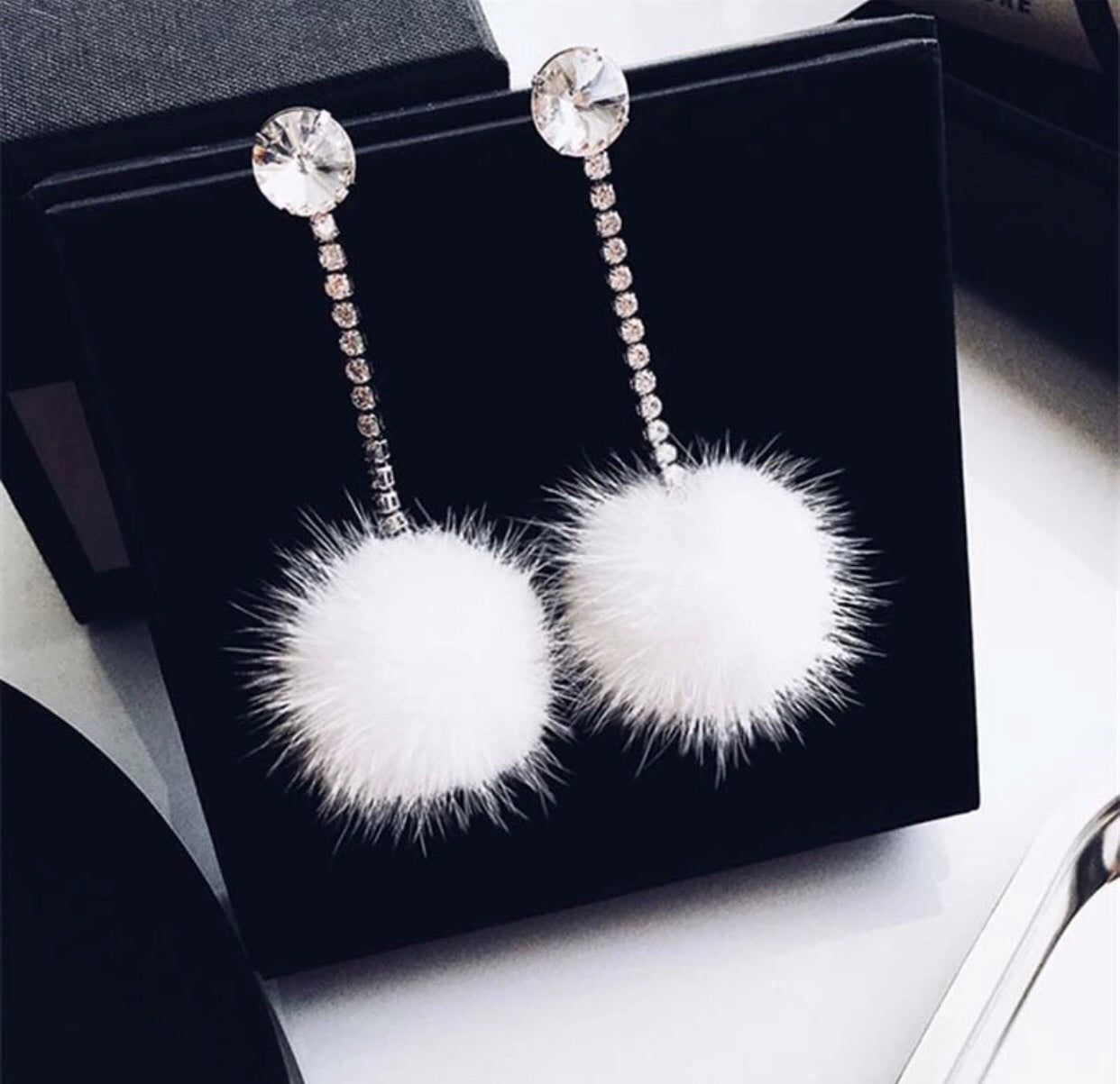 Crystal stud earrings with white pom poms