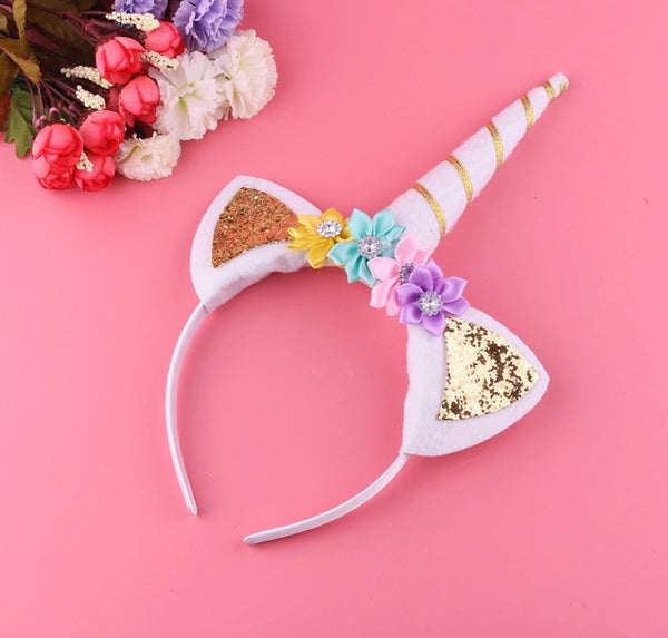 Unicorn headband with rainbow flowers
