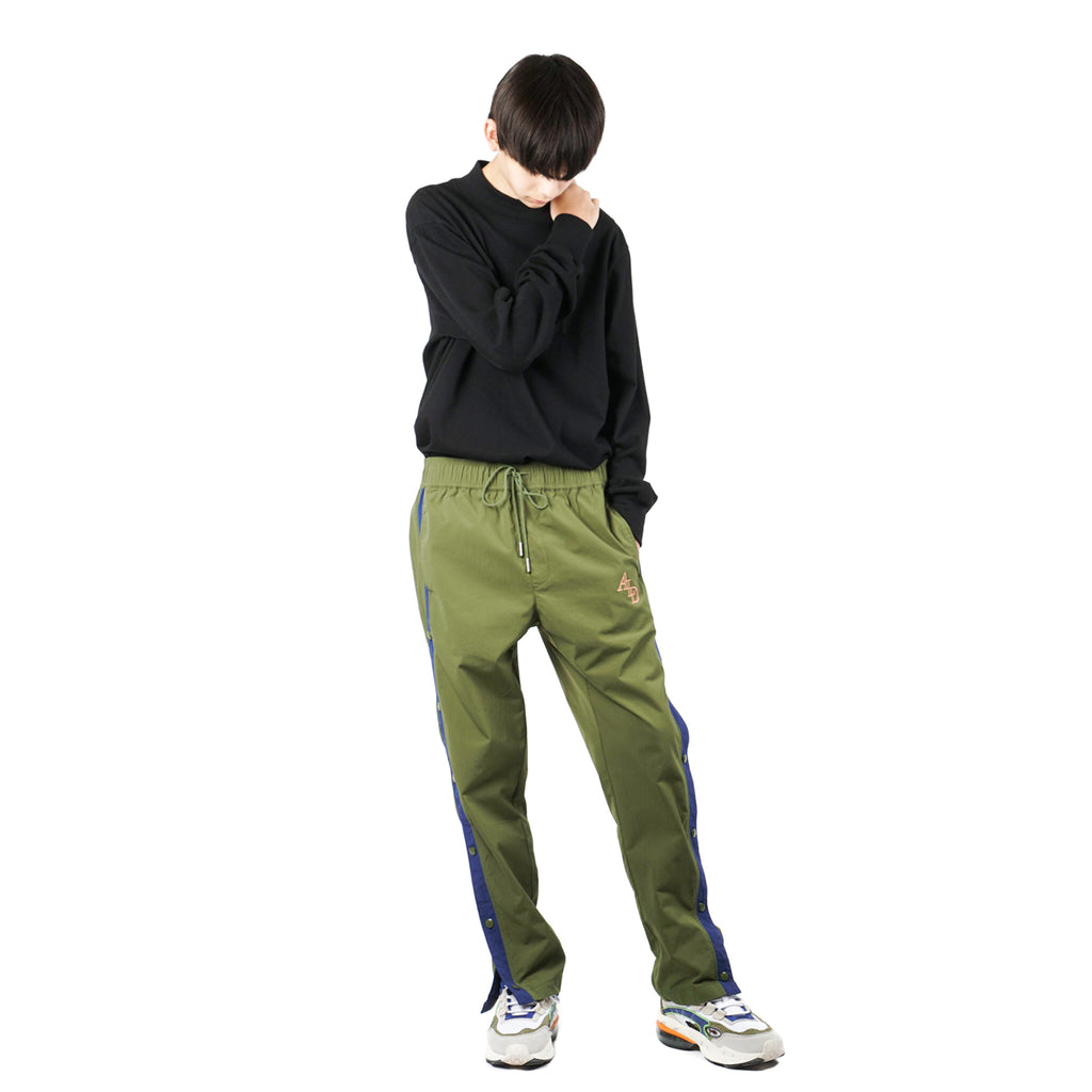 WARM-UP NYLON TRACK PANTS