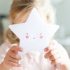 a battery operated night light for kids in white star shape with auto off timer mode