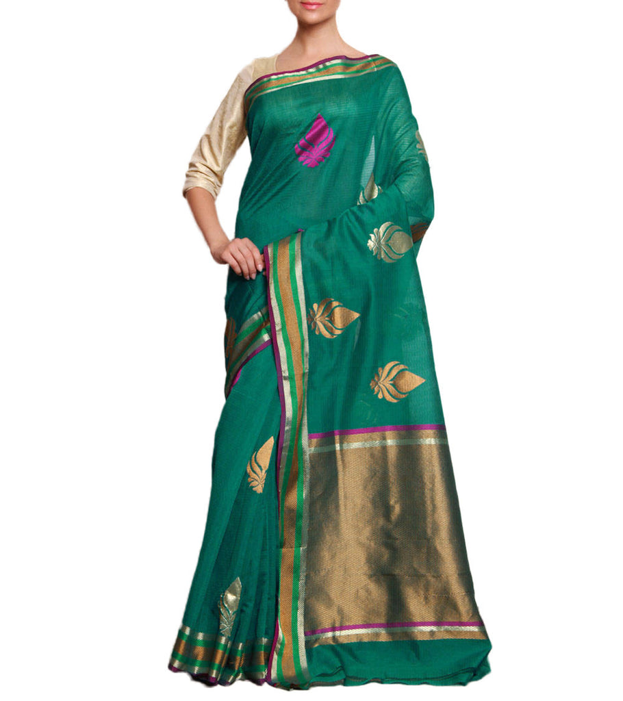 Front side image of model wearing green Silk Cotton Saree