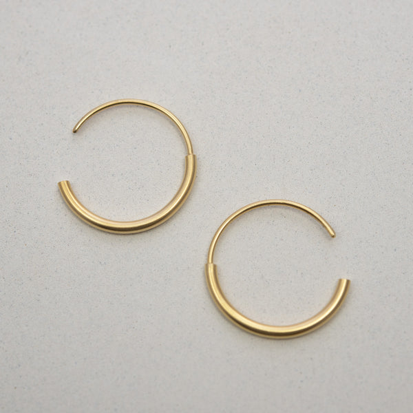 Handcrafted gold hoops by AgJc