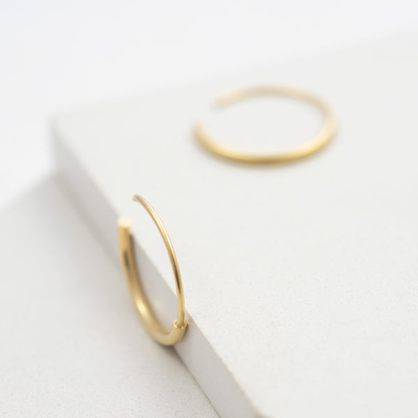 Modern gold hoops by AgJc