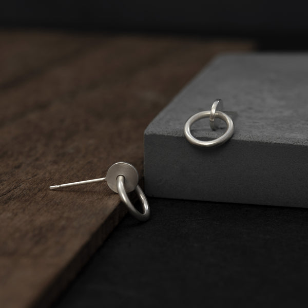Interlocking dot and circle studs by AgJc