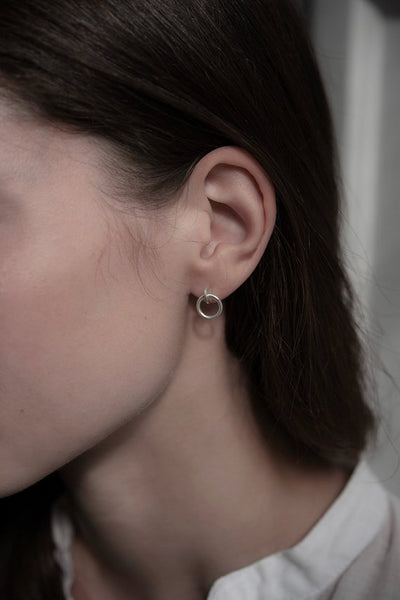 These stud earrings are handmade from sterling silver by AgJc