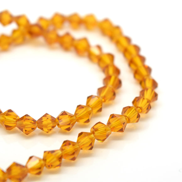 STAR BEADS: FACETED BICONE GLASS BEADS - TOPAZ - Bicone Beads