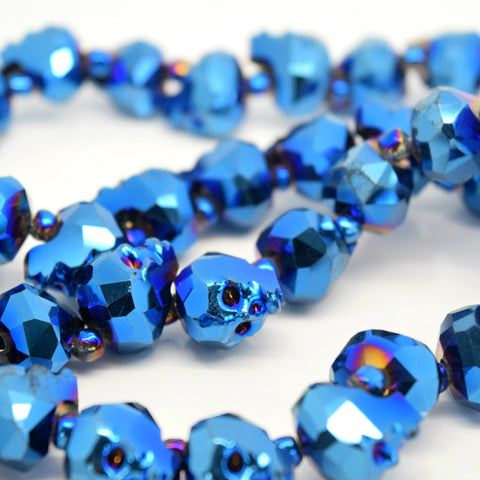 2 X FACETED GLASS CRYSTAL METALLIC BLUE SKULL BEADS 14MM, 22MM