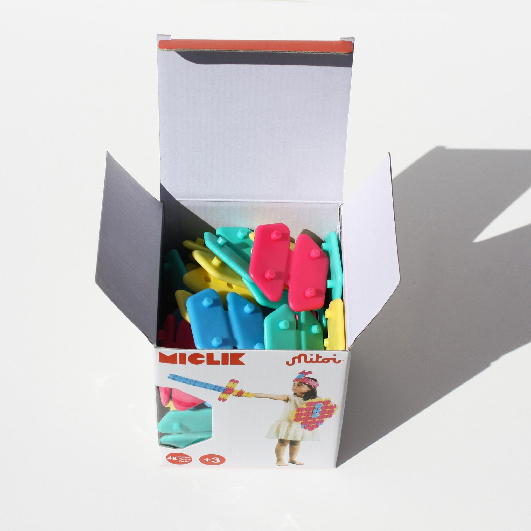 Miclik by Mitoi is a colourful modular construction toy. 48 flat hexagons can bend along a fold, allowing them to be easily snapped together for creative play.