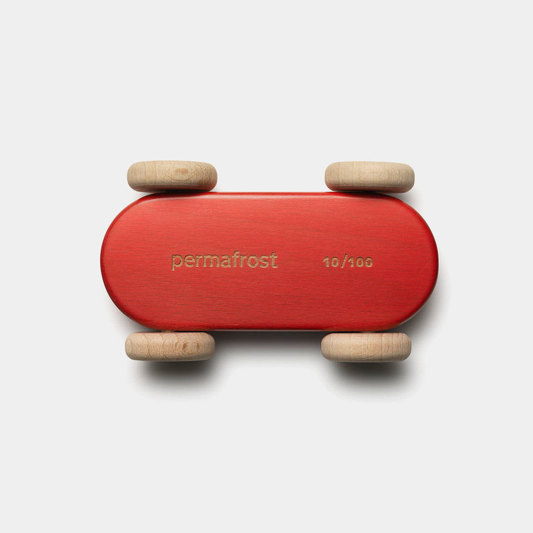 Permafrost's red wooden 100 racer car toy seen from the bottom