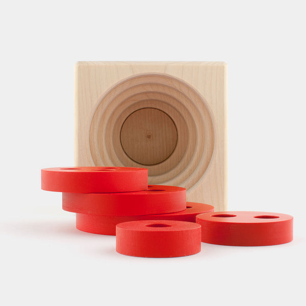 Designed for Jukka Toys by Kurt Naef in the 1970s as a way to teach young children coordination skills and size differences, the Disk Cube is a classic.