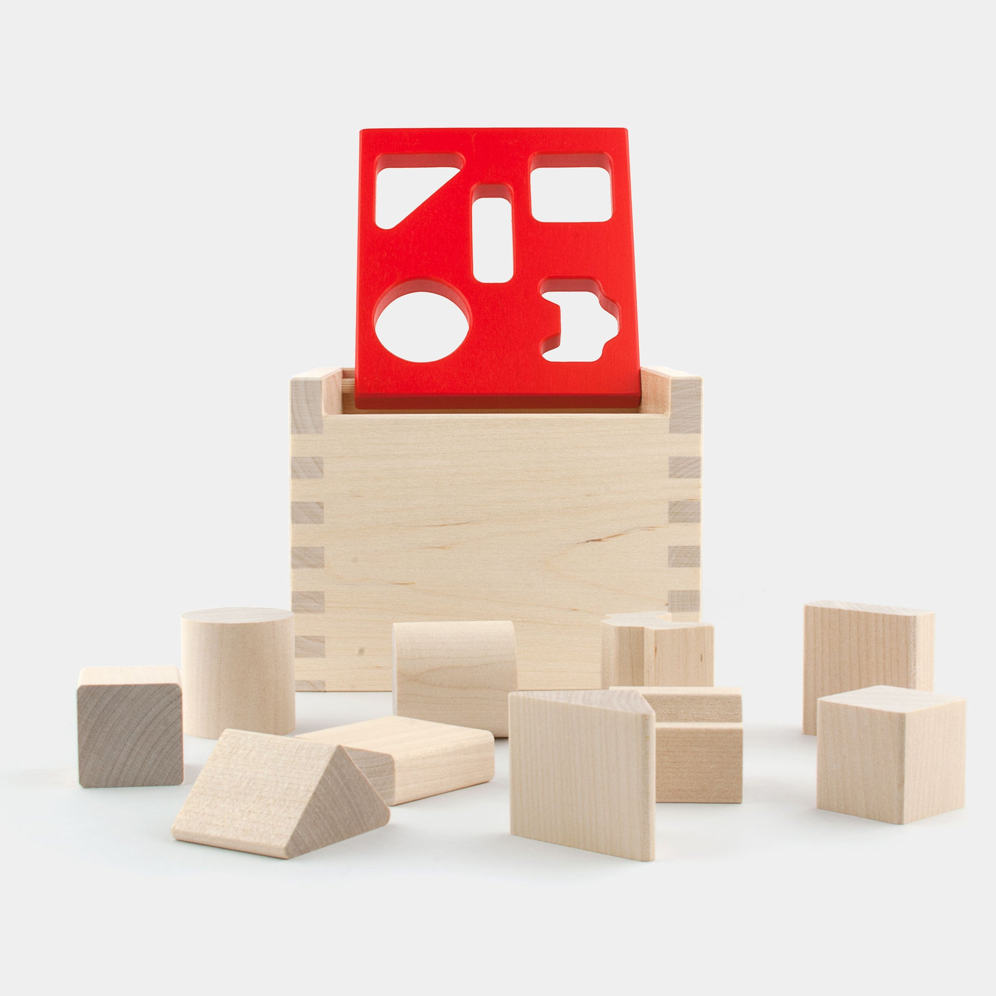 The classic birch wood posting box with 10 wooden blocks from the 1970s is handmade in Finland by Jukka Toys.