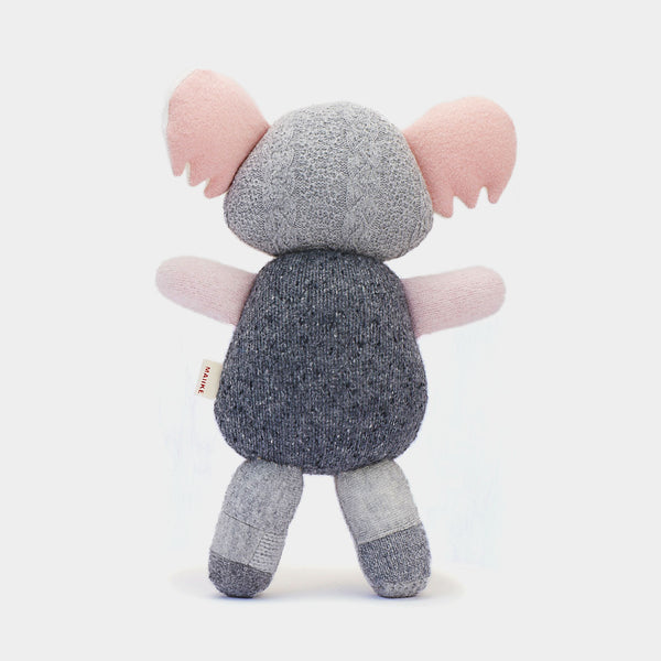 Koala from Melbourne, Australia. Handmade in the finest recycled wool. It comes in the finest pink, charcoal and grey shades, and each little koala is unique.