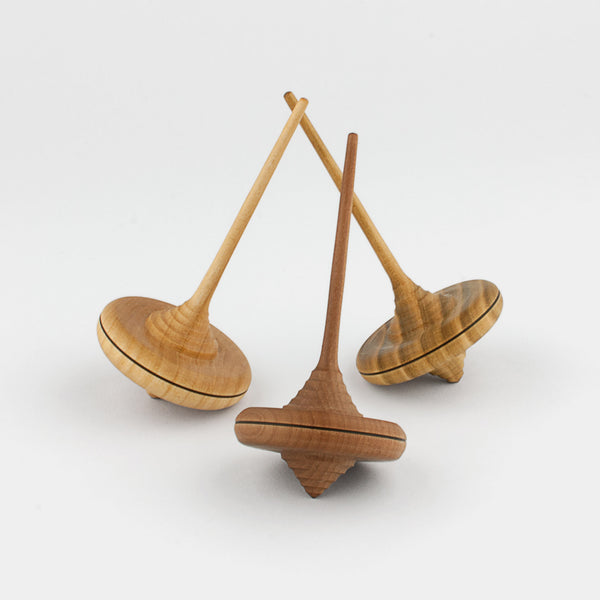 Handcrafted in limited quantities in Austria, these wooden spinning tops are made by Klaus and Margit Mader from Mader Kreiselmanufaktur.