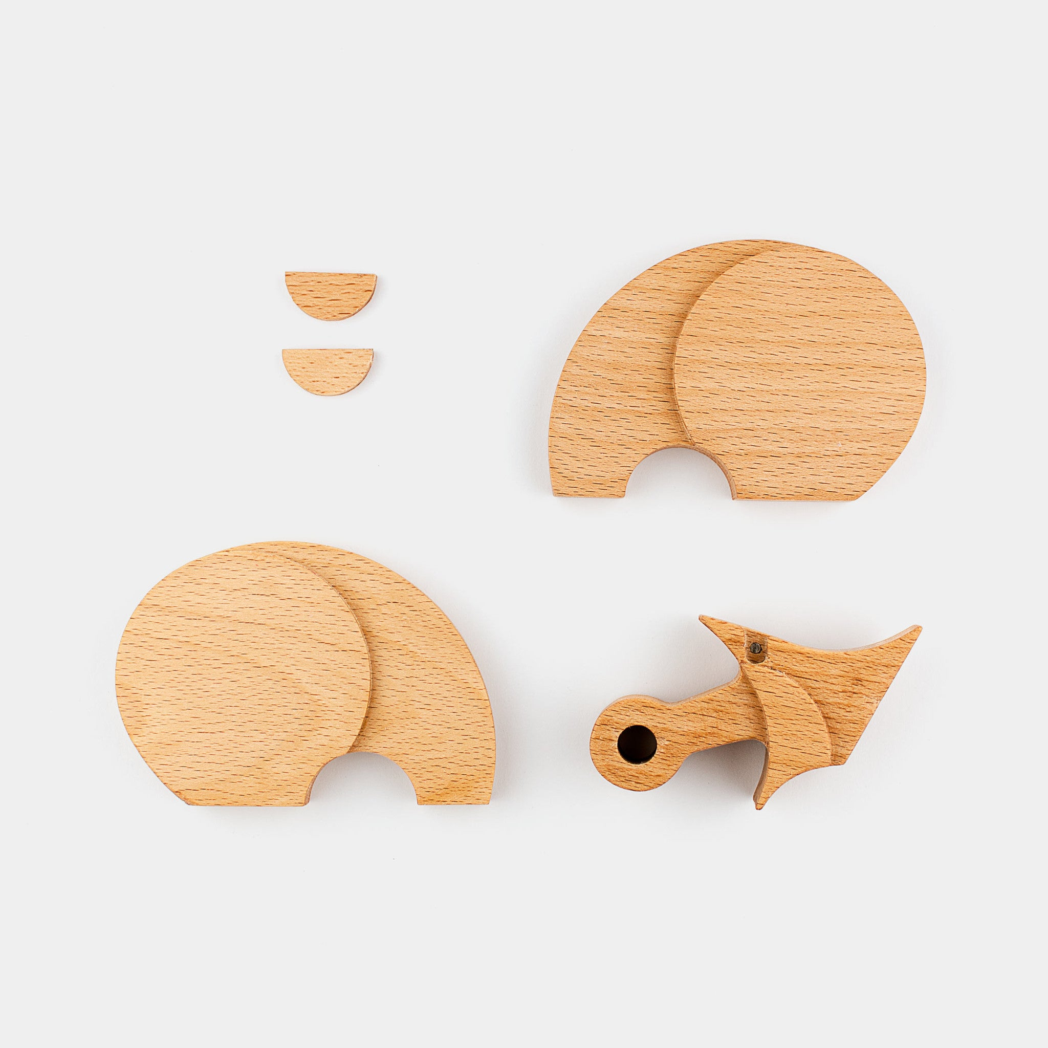 Riin The Rhinoceros by Wodibow — A great wooden animal puzzle with internal magnets that allow assembly of each puzzle and a bit of movement.
