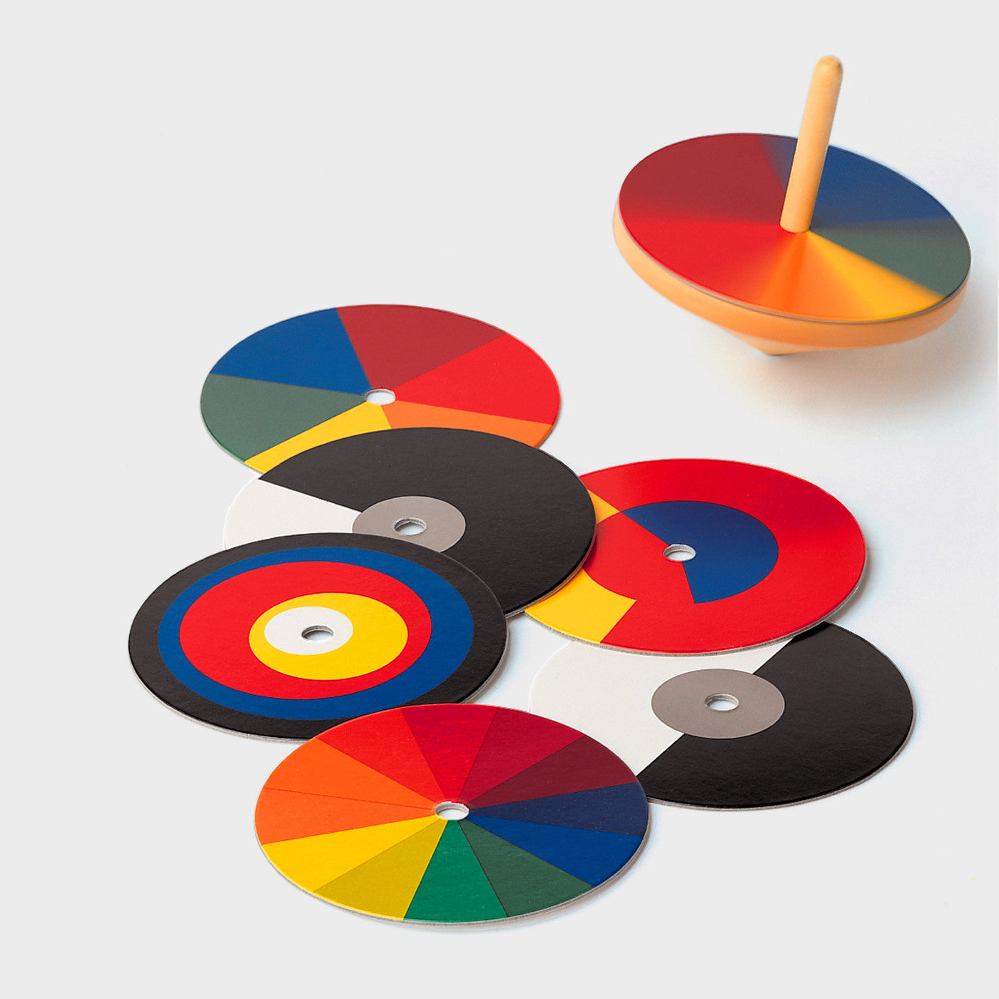 "This classic wooden Spinning Top or ""Optischer Farbmischer"" is designed by Ludwig Hirschfeld-Mack at Bauhaus in the 1920s."