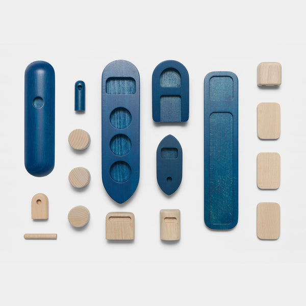 Permafrost's Shipping wooden toy set with all the 17 parts layed out