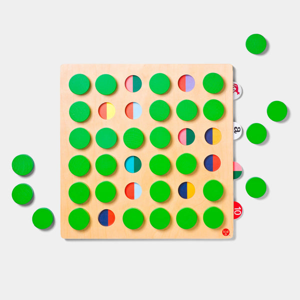 Kid O's memory match 36 has circular green wooden blocks to cover the 36 symbols, seen from above