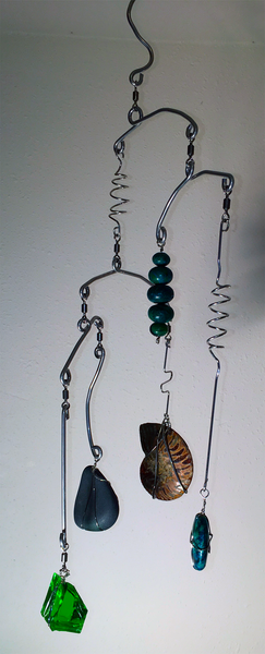 Handcrafted Artisan Mobile featuring Silver Wire Wrapped Rainbow Ammonite Fossil, Turquoise, Polished River Rock.