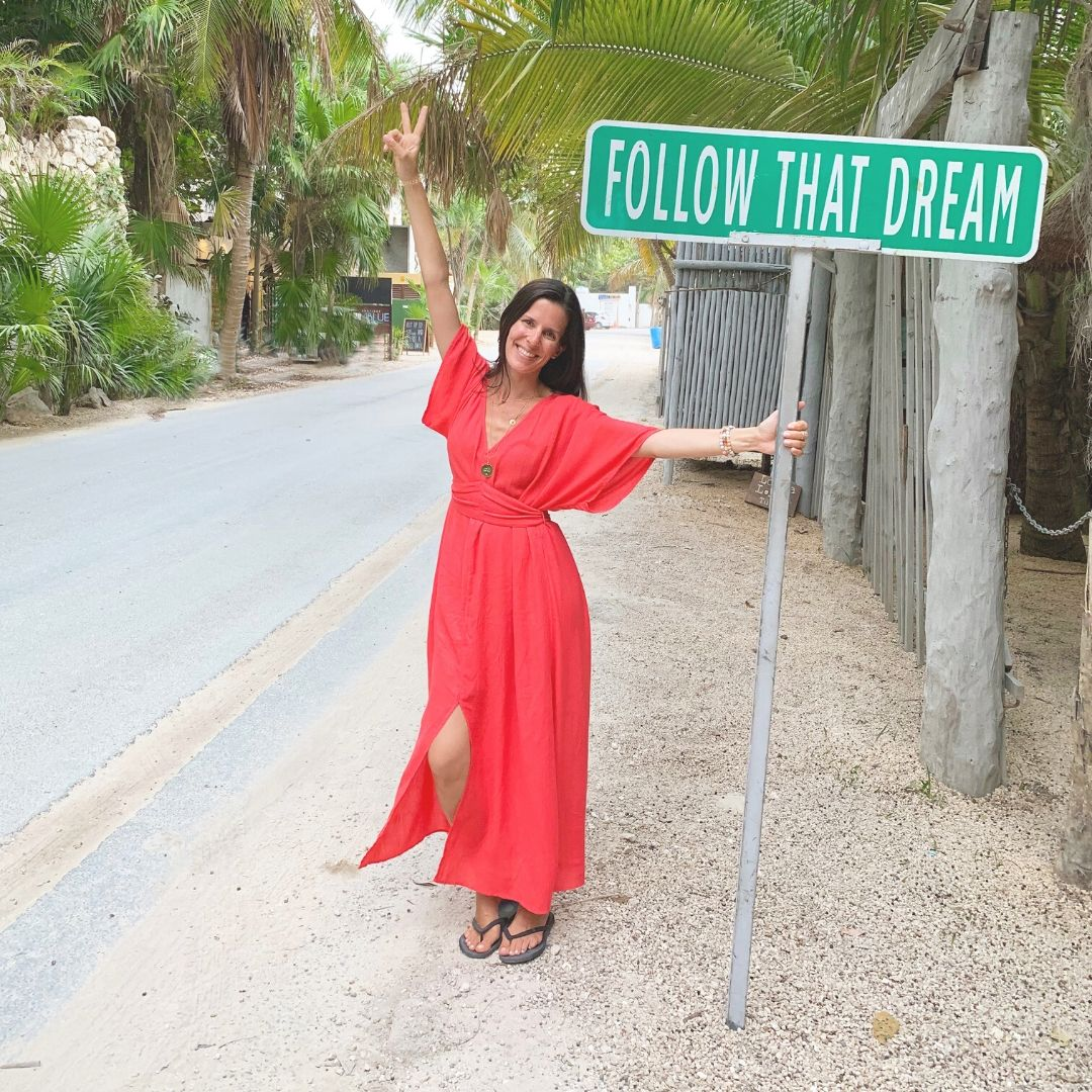 Jennifer Ciraulo Blooming Lotus Jewelry Founder holding follow that dream sign tulum