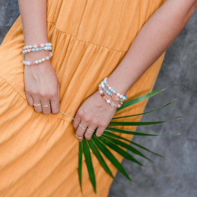Gemstone Bracelets Blooming Lotus Jewelry on model wearing yellow dress