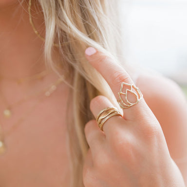 Gold stacking rings lotus love mantra on model closeup - Blooming Lotus Jewelry