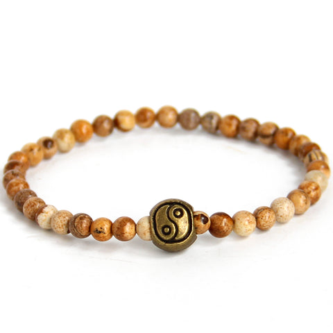 Om (solid 14K gold)
