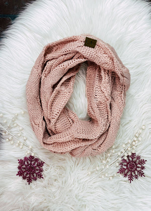 pink knit scarf on white rug
