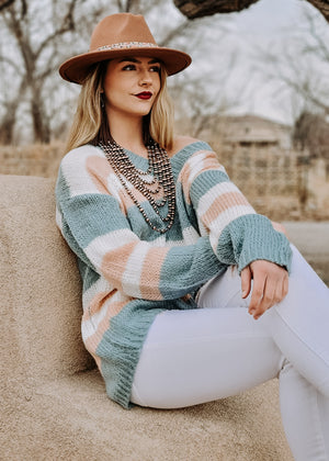 Mint Stripe Slouchy Sweater on blonde model with accessories