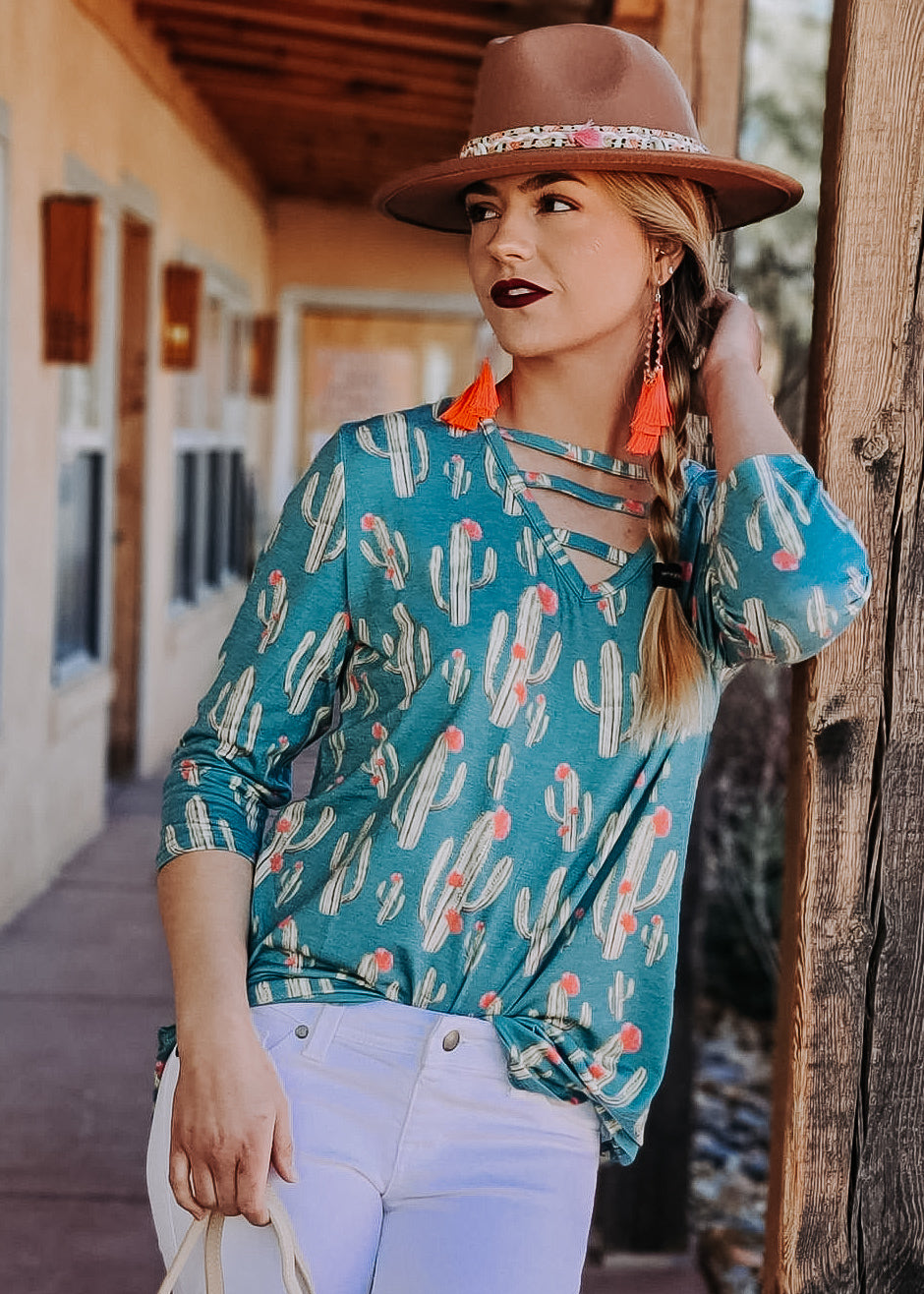 Jade Cactus V Neck 3/4 Sleeve Top with blonde model and accessories