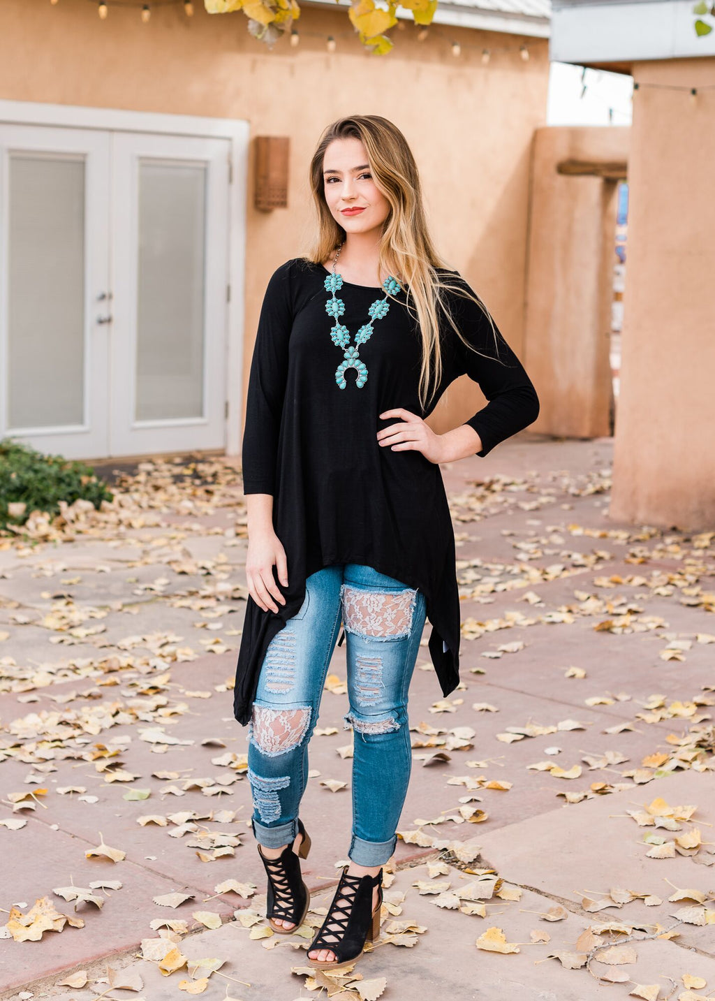Black Lace Up Long Sleeve Top with shark bite detail on blonde model wearing turquoise squash blossom