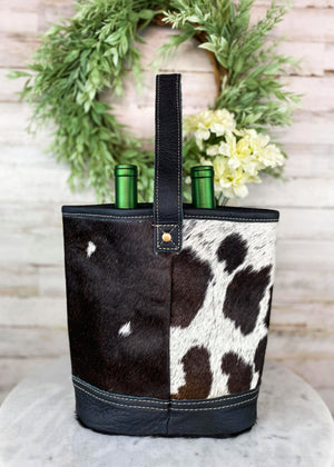 Back of Black & White Cowhide 2 Bottle Caddy with Black Handle Taken Inside with Studio Lights