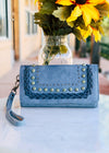 Blue Braided Embossed Wallet/Wristlet with Patina and Gun Metal Accents and Blue Braid, Taken Outside on White Table
