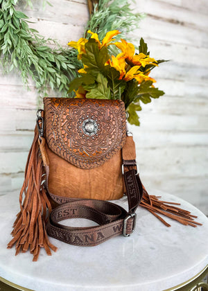 Small Brown Crossbody with Brown Fringe on Sides and Aztec Print Flap Over Closure with Silver Concho Detail