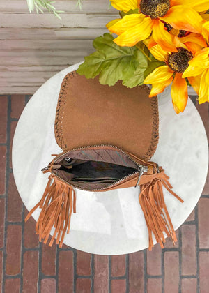 Inside of Small Brown Crossbody with Brown Fringe on Sides and Aztec Print Flap Over Closure with Silver Concho Detail