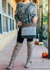 Brown Diamond Aztec Shoulder Crossbody Handbag with Leather and Canvas Accents, on Blonde Model Taken Outside in Natural Light